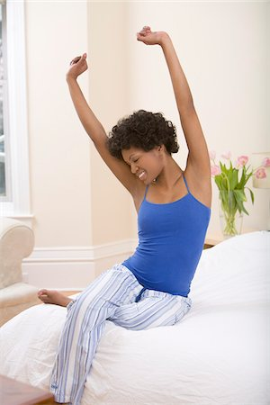 Woman Stretching on Bed Stock Photo - Rights-Managed, Code: 700-05389238