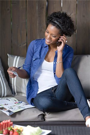 person on phone with credit card - Woman Placing Order Over Telephone Stock Photo - Rights-Managed, Code: 700-05389241