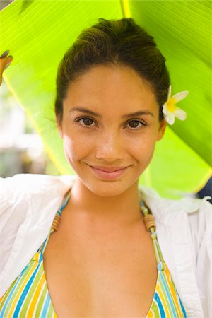 Close-Up Portrait of Woman Under Shade of Leaf Stock Photo - Rights-Managed, Code: 700-05389257