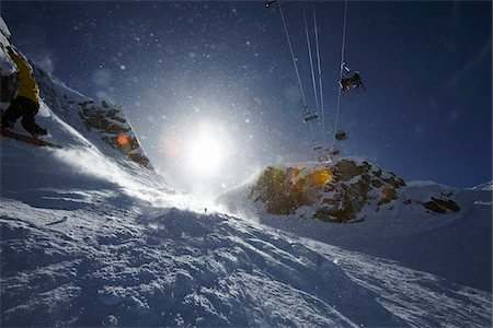 Ski Lift and Bright Sun, Whistler Mountain, Whistler, British Columbia, Canada Stock Photo - Rights-Managed, Code: 700-05389342