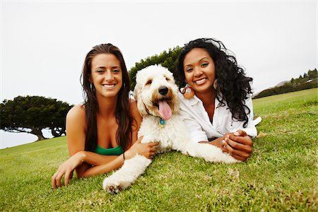 Two Women Lying on Ground with Dog Stock Photo - Rights-Managed, Code: 700-05451042