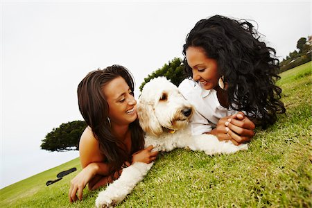 Two Women Lying on Ground with Dog Stock Photo - Rights-Managed, Code: 700-05451043