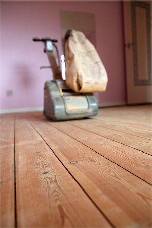 Electric Floor Sander in Room with Sanded Floors Stock Photo - Rights-Managed, Code: 700-05451144