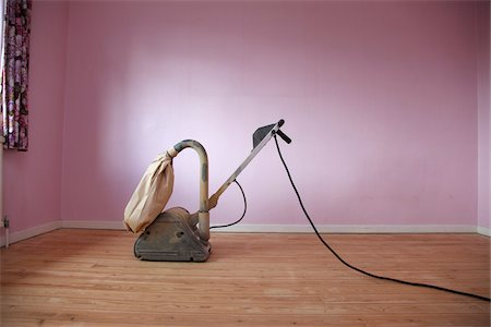 Electric Floor Sander in Room with Pink Walls Stock Photo - Rights-Managed, Code: 700-05451145