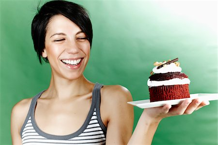 Woman Holding Cake on Plate Stock Photo - Rights-Managed, Code: 700-05452064