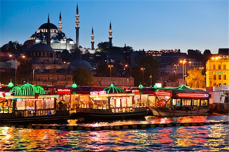 Boats in front of Suleymaniye and Yeni Camii Mosques, Eminonu District, Istanbul, Turkey Stock Photo - Rights-Managed, Code: 700-05609544