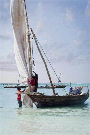 Fishermen on Dhow Preparing to Set Sail, Zanzibar Island, Tanzania Stock Photo - Rights-Managed, Code: 700-05609669