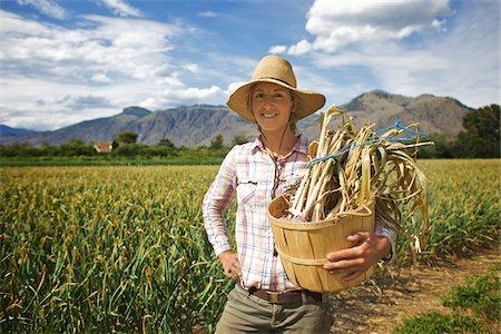 farmhand (female) - Portrait of Farmer Holding Basket on Organic Farm Stock Photo - Rights-Managed, Code: 700-05602726