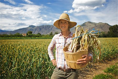 farmhand (female) - Portrait of Farmer Holding Basket on Organic Farm Stock Photo - Rights-Managed, Code: 700-05602726