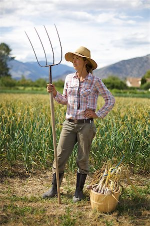 farmhand (female) - Farmer Holding Pitchfork on Organic Farm Stock Photo - Rights-Managed, Code: 700-05602728
