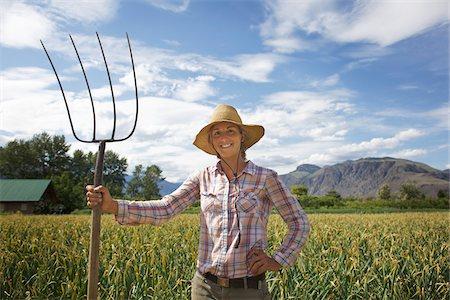 farmhand (female) - Portrait of Farmer with Pitchford on Organic Farm Stock Photo - Rights-Managed, Code: 700-05602729