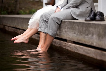Bride and Groom Sitting on Dock Stock Photo - Rights-Managed, Code: 700-05641764