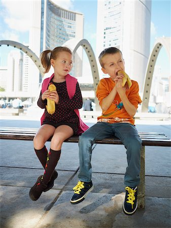 Boy and Girl Eating Hot Dogs, Nathan Philips Square, Toronto, Ontario, Canada Stock Photo - Rights-Managed, Code: 700-05641837