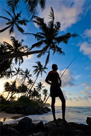 Fisherman Standing on Beach, Ahangama, Sri Lanka Stock Photo - Rights-Managed, Code: 700-05642147