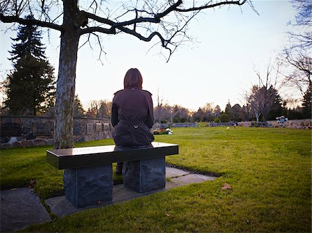 rear - Woman Sitting on Bench in Cemetery Stock Photo - Rights-Managed, Code: 700-05656534