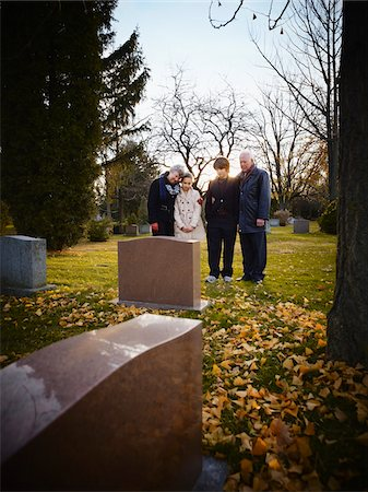 Family Grieving in Cemetery Stock Photo - Rights-Managed, Code: 700-05656532