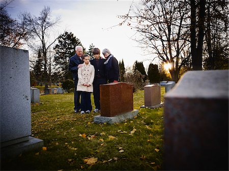 dead woman - Family Grieving in Cemetery Stock Photo - Rights-Managed, Code: 700-05656533
