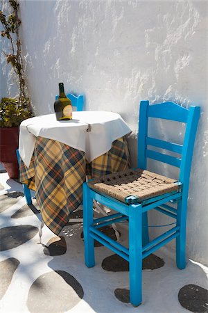 Table and Chair, Chora, Mykonos Town, Mykonos, Cyclades Islands, Greece Stock Photo - Rights-Managed, Code: 700-05653128