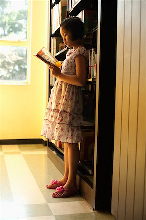 preteen thong - Girl Reading in Library Stock Photo - Rights-Managed, Code: 700-05653169