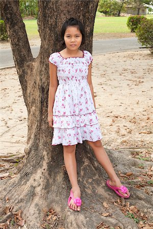 preteen thong - Girl Leaning Against Tree, Bangkok, Thailand Stock Photo - Rights-Managed, Code: 700-05653174