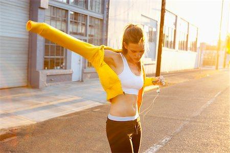 Runner Putting on Sweatshirt Stock Photo - Rights-Managed, Code: 700-05662582