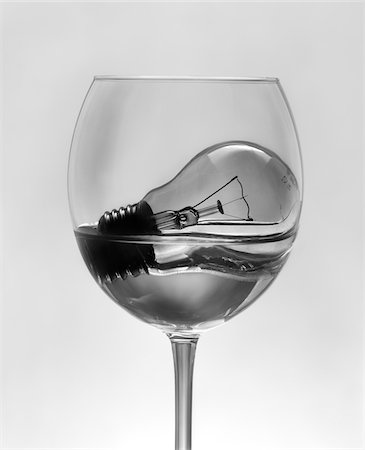 Light Bulb Soaking in Water in Wine Glass Stock Photo - Rights-Managed, Code: 700-05756176