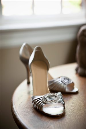Silver High Heel Shoes on Table Stock Photo - Rights-Managed, Code: 700-05756378