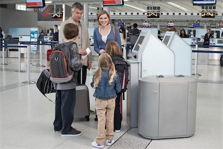 rear - Family Checking In at Airport Stock Photo - Rights-Managed, Code: 700-05756416