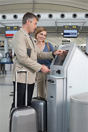 property release - Couple Checking In at Airport Stock Photo - Rights-Managed, Code: 700-05756418