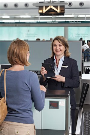 Woman at Ticket Counter in Airport Stock Photo - Rights-Managed, Code: 700-05756435