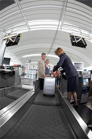 Family Checking Luggage in Airport Stock Photo - Rights-Managed, Code: 700-05756432