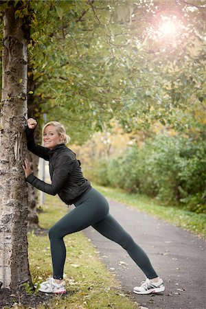 Jogger Stretching Against Tree Stock Photo - Rights-Managed, Code: 700-05762107
