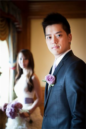 Portrait of Groom with Bride in Background Stock Photo - Rights-Managed, Code: 700-05786434