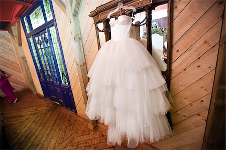 Wedding Gown Hanging in front of Mirror Stock Photo - Rights-Managed, Code: 700-05786468