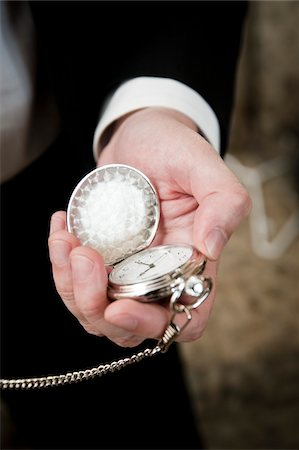 Close-Up of Man Holding Pocket Watch Stock Photo - Rights-Managed, Code: 700-05786479