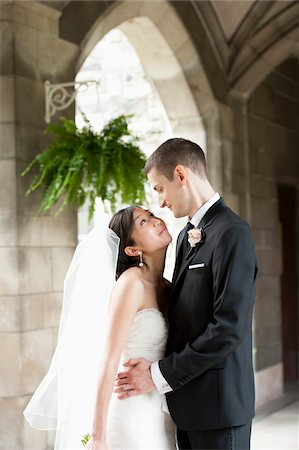 Bride and Groom Looking at Each Other Stock Photo - Rights-Managed, Code: 700-05786622