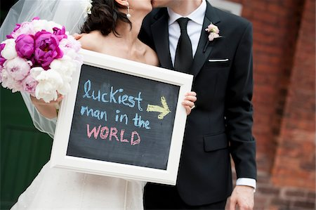 Bride and Groom with Chalkboard Sign Stock Photo - Rights-Managed, Code: 700-05786694