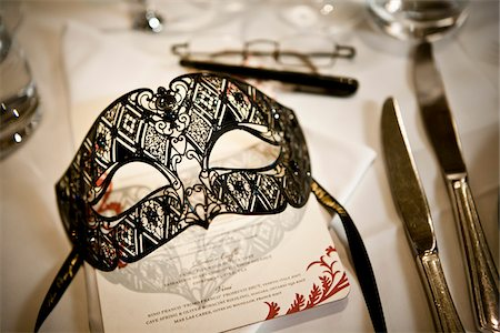 Mask at Place Setting Stock Photo - Rights-Managed, Code: 700-05803127