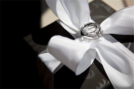 diamond - Wedding Rings on White Satin Bow Stock Photo - Rights-Managed, Code: 700-05803328