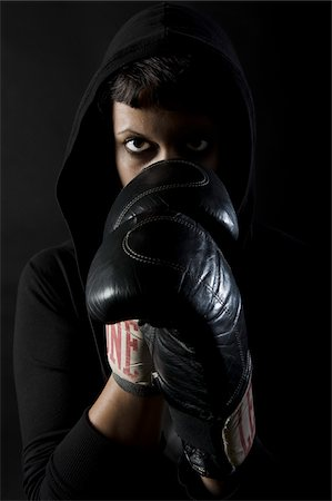 dominant woman - Woman Wearing Boxing Gloves and Hoodie Stock Photo - Rights-Managed, Code: 700-05803401