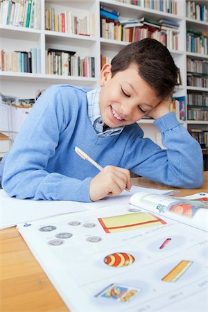 Boy Doing Homework Stock Photo - Rights-Managed, Code: 700-05803518
