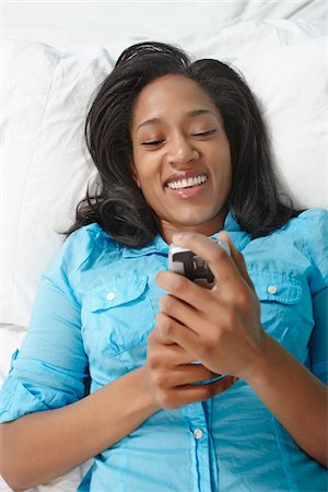 peter griffith - Woman Using Phone in Bed Stock Photo - Rights-Managed, Code: 700-05803559