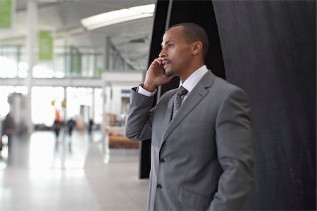 Businessman Using Cell Phone in Airport Stock Photo - Rights-Managed, Code: 700-05821753