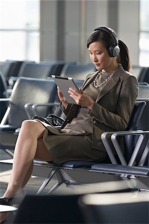 Businesswoman with Tablet PC in Airport Stock Photo - Rights-Managed, Code: 700-05821768