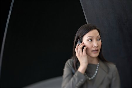 people in panic - Businesswoman Talking on Cell Phone in Airport Terminal Stock Photo - Rights-Managed, Code: 700-05821760