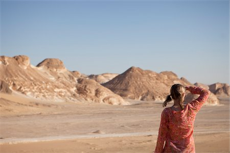 Woman Looking into the Distance, Black Desert, Egypt Stock Photo - Rights-Managed, Code: 700-05822130