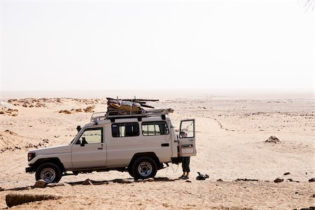 Woman with Jeep at Ain Serru, White Desert, Egypt Stock Photo - Rights-Managed, Code: 700-05822133
