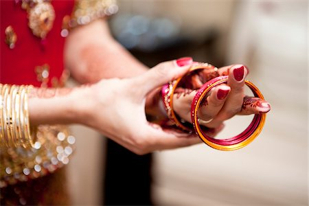 Bride Putting on Bracelets Stock Photo - Rights-Managed, Code: 700-05855075