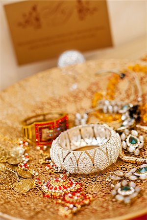 Jewelry on Gold Platter Stock Photo - Rights-Managed, Code: 700-05855115