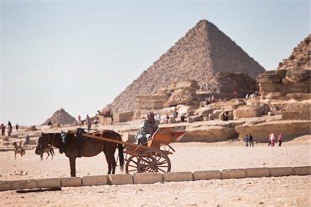 Horse and Cart at Great Pyramids at Giza, Cairo, Egypt Stock Photo - Rights-Managed, Code: 700-05855196